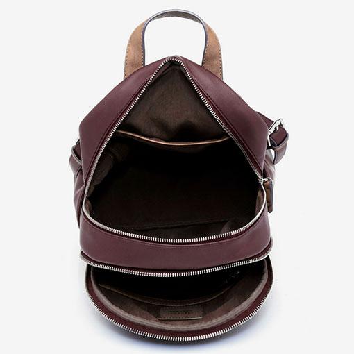 mochila de la marca abaccino con panel delantero acolchado en la parte interior, con dos espacios de gran almacenamiento en color granate