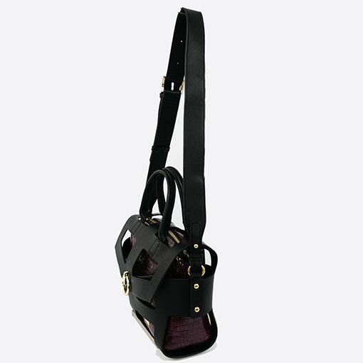 lateral del bolso calado con anilla burgundy de la marca noco complementos