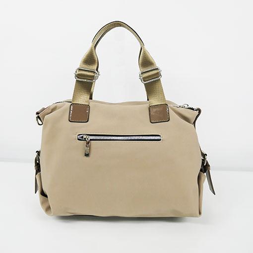 trasera del bolso engomado en color beige de la marca noco complementos