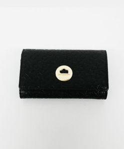 cartera grabada en color negro de la marca don algodón