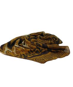fular con estampado étnico-africano estilo bagamon con tela fina y en las mismas tonalidades mostaza