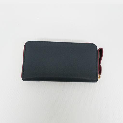 trasera de la cartera alexandra en color gris de la marca don algodón