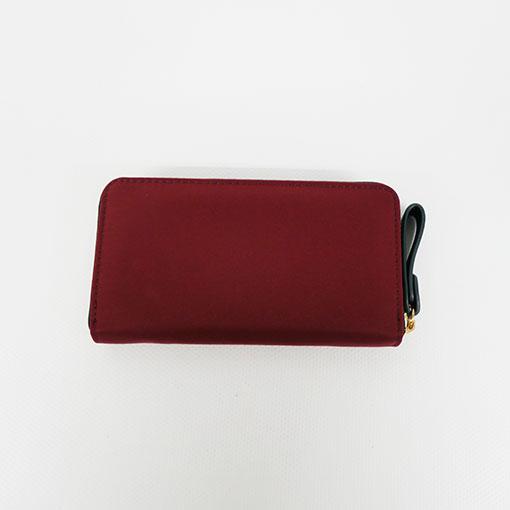 trasera de la cartera alexandra en color rojo de la marca don algodón