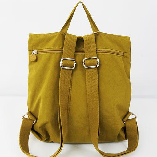 trasera de la mochila aloha en color amarillo de la marca bensan
